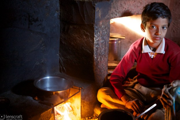 the boy by the cooking fire / osian, india