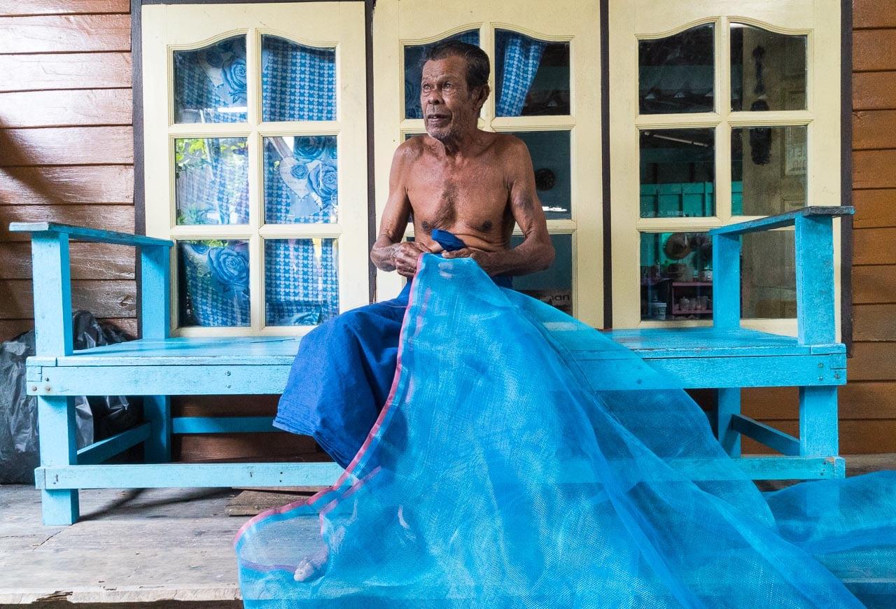 mending nets / koh panyee, thailand