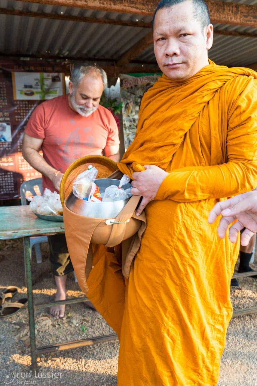 monk with food / wat pha luang ta bua, thailand