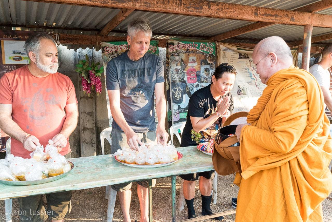 feeding the abott / wat pha luang ta bua, thailand