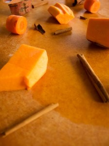 ingredients for pureed orange soup include sweet potato, butternut squash, carrot, and cinnamon sticks