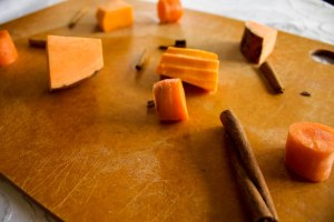 ingredients for soup are cinnamon sticks, carrots, sweet potatoes, butternut squash