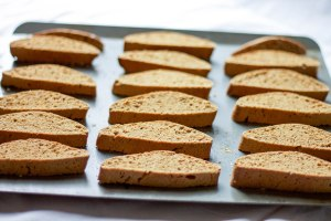 slices of S.O.S. biscotti laid out on pan for baking