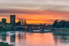 Sunset over Verona's Ponte Scaligero and Adige River