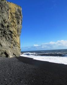 a beach with black lava