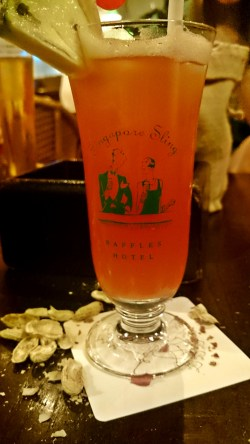 Having a Singapore Sling at the Long Bar in the Raffles Hotel
