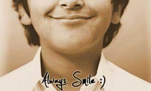 arti makna senyum