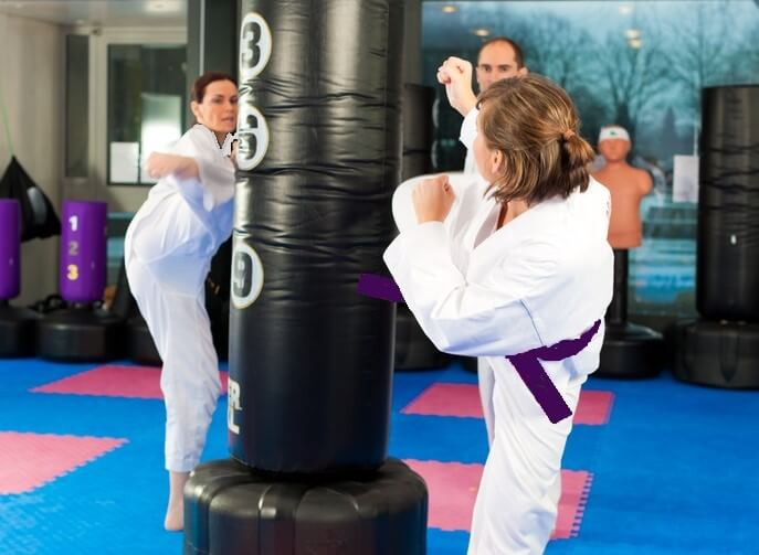 Leominster Martial Arts_Two Females kicking and Instructor2 (2)