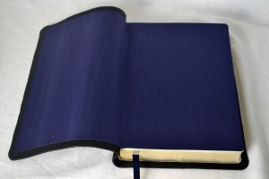 Instead of standard leatherette, this soft-tanned goatskin has navy silk moire end pages.