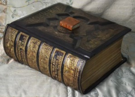 A large Victorian family Bible with a tiny thumb Bible