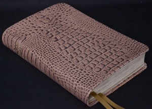 Not real cowhide, but the alligator embossing is an elegant look!