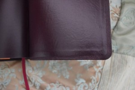 We construct the cover with the end page glued over the raw edge of the leather, a clean look.
