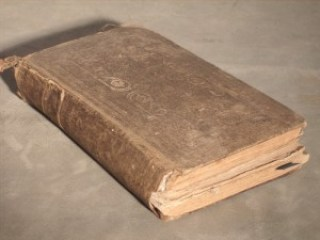 Rare cloth book before restoring it at Leonard's