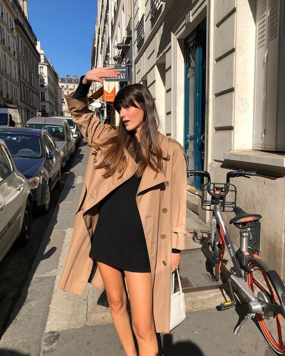 french girl with beige trench coat