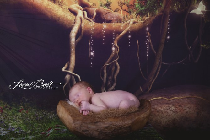 newborn in a fantasy forest