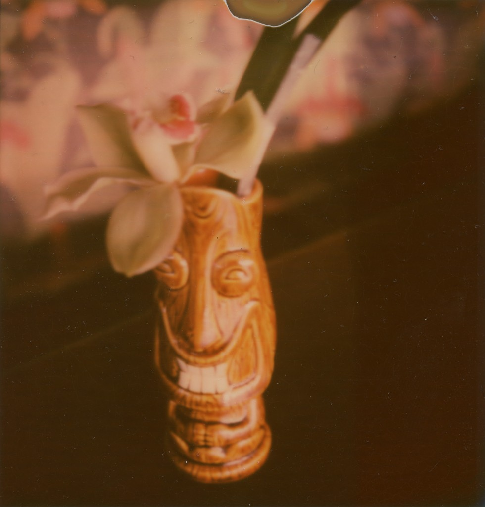 tiki mug cocktail with orchid flower garnish. polaroid sx-70, impossible project px-70 film. copyright leonie wise