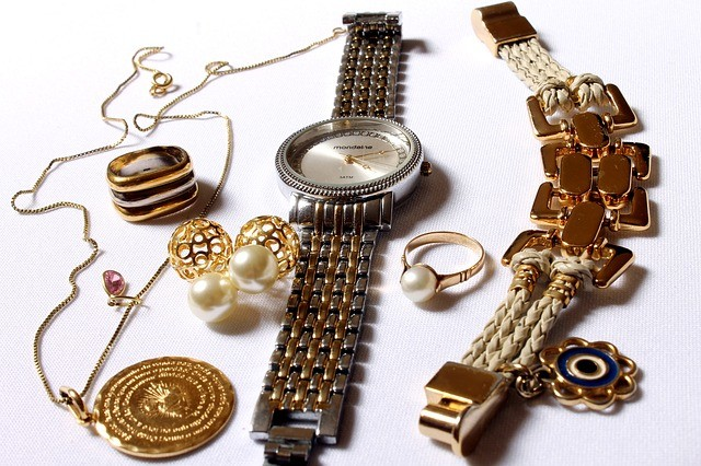 A selection of jewelry and a watch.