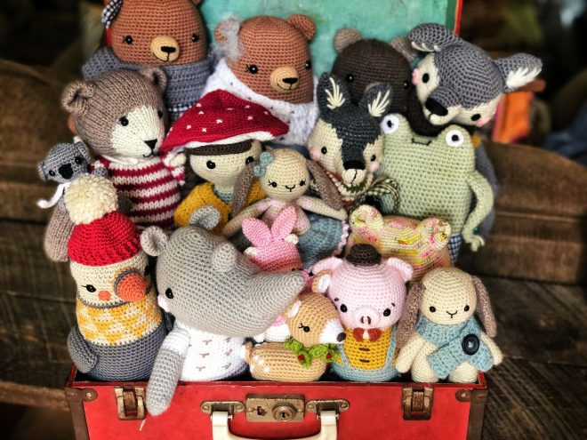 View from above of all the animals in the suitcase.