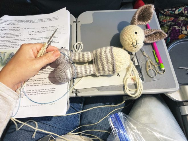 Traveling with my handmade project! Knitting a bunny rabbit on an airplane.