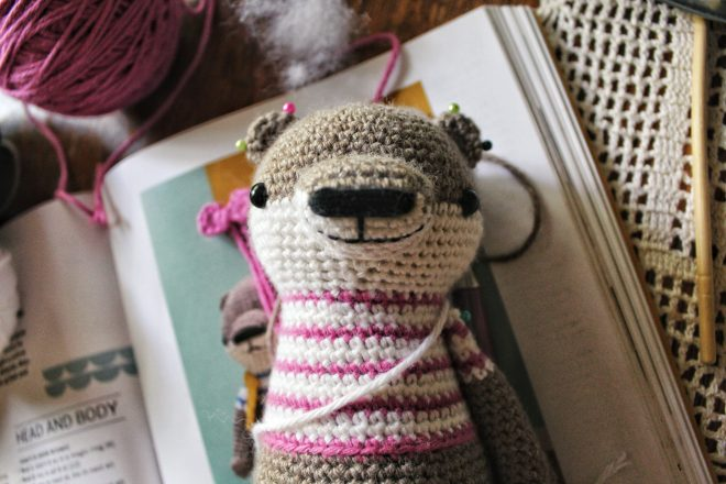 Facial detail of amigurumi otter.