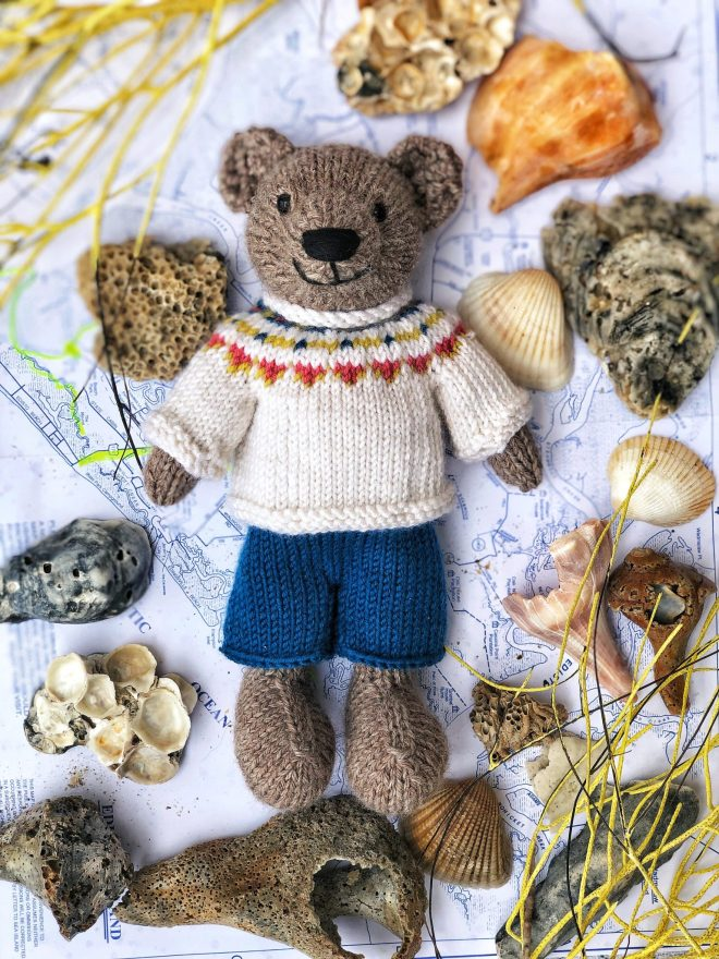 Hand knit teddy bear with fair isle sweater. Made on Edisto Island.
