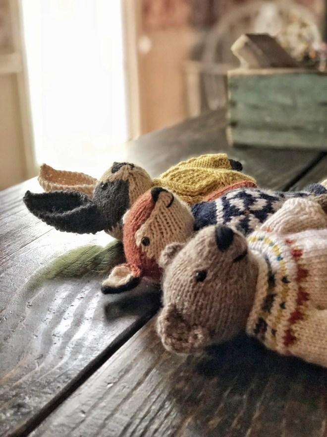 Knitted teddy bear, fox, and bunny.