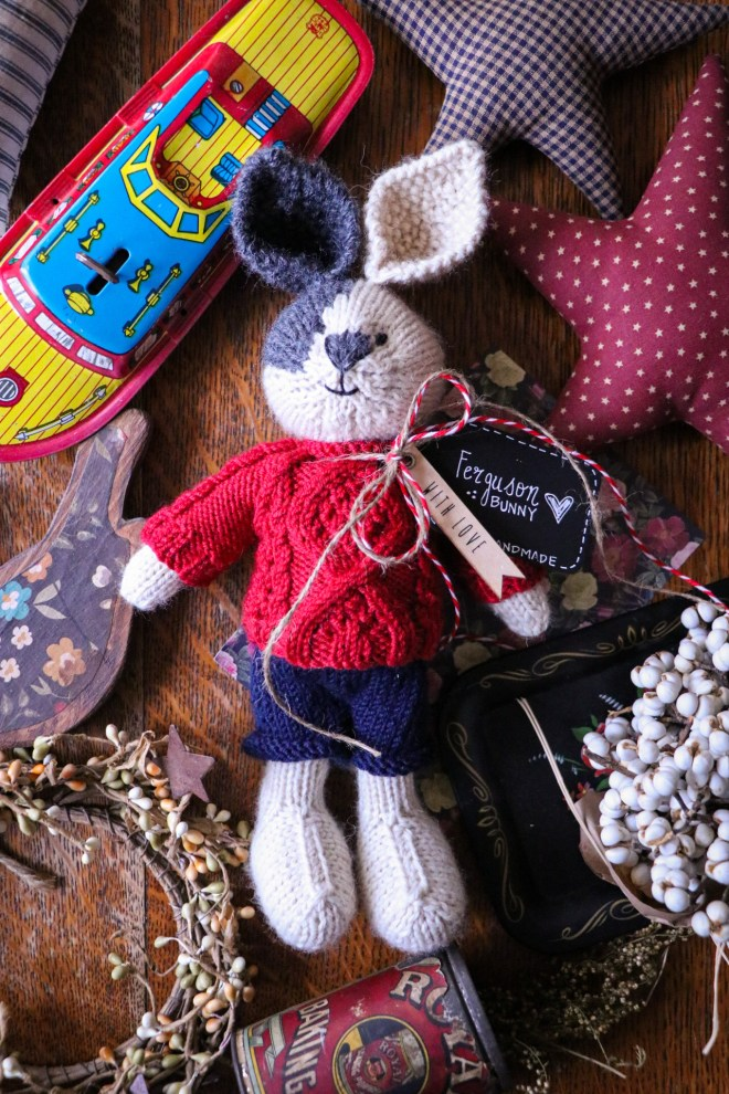 Bunny with a cable knit sweater.