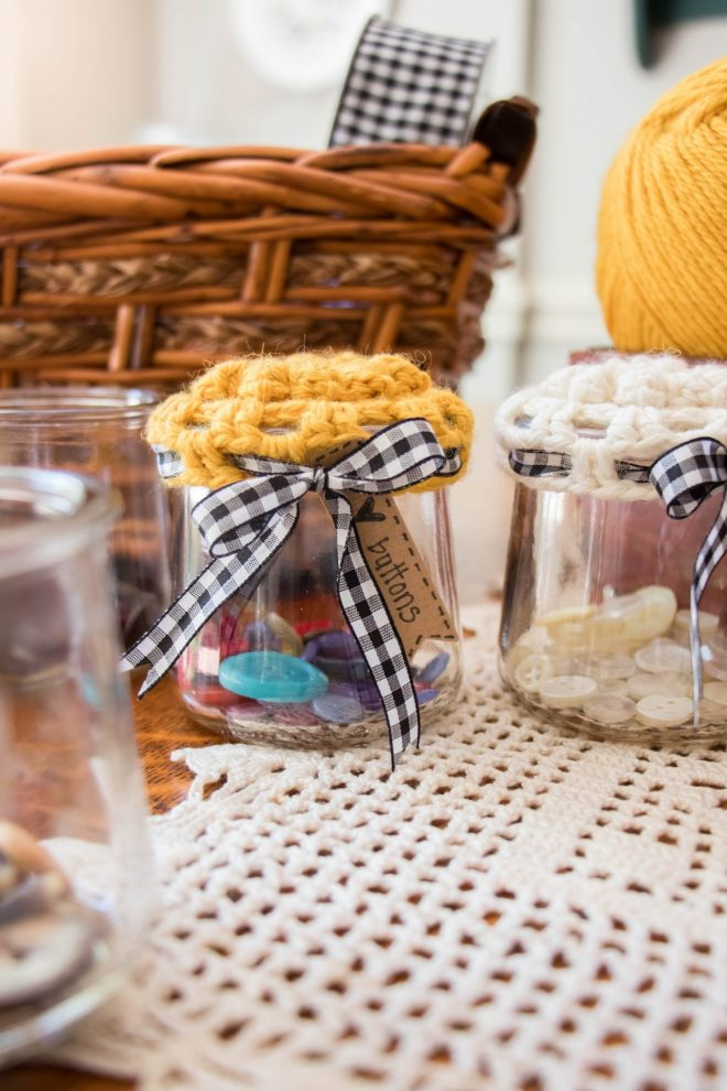 Glass jar with crocheted lid cover.