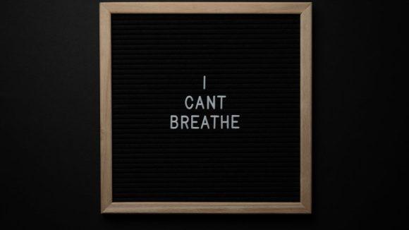sign i cant breath on blackboard