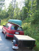 Our Golf, our canoe and our trailer in some shade at the Visitor's Centre.