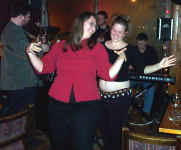 Tracey and Mel belly dancing to