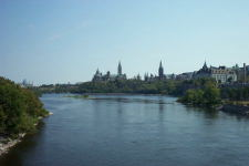 A view of the Ottawa River looking east from a bridge.  The National Gallery, Parliament Hill and the Supreme Court can all be seen. August 2002