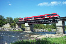 Ottawa's new spiffy O-Train crossing the Rideau River near Carleton University, June 2002.