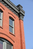 I like the way the sky, the trim and the brick contrast each other.