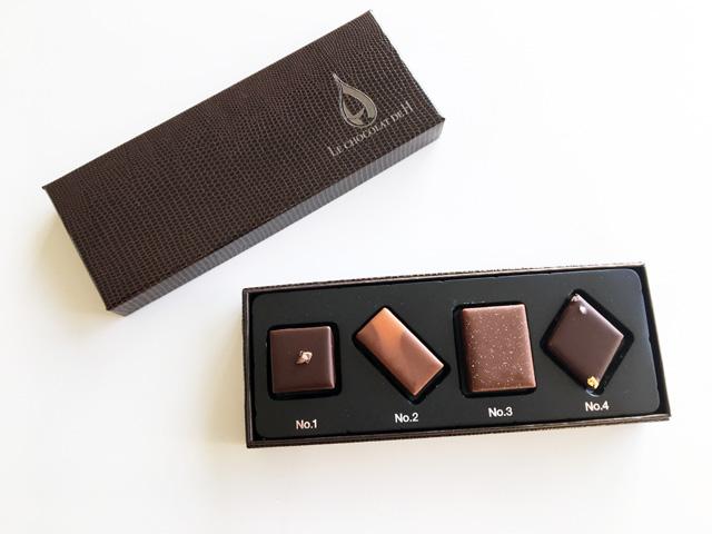 LE CHOCOLAT DE H,ポール バセット C.C.C.ショコラ陰翳礼讃の箱を開けると中に4粒の デザインの異なるショコラが入っている,