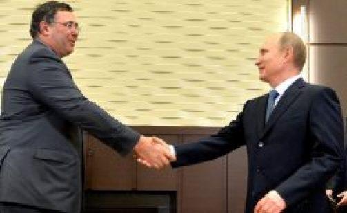 Rencontre entre le PDG de Total P. Pouyanné et V. Poutine