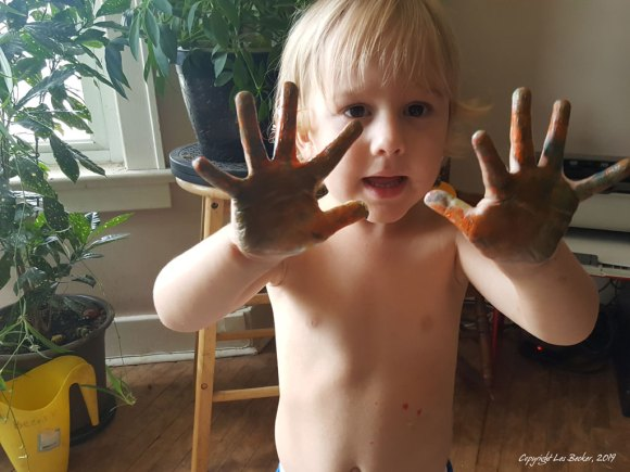 Toddler with paint on hands