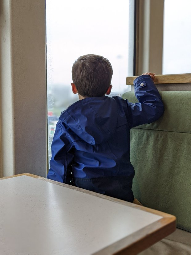 T looking out the window from the Red Funnel ferry