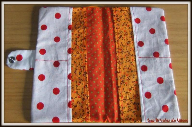 Protège chéquier tissu batik tons orangés