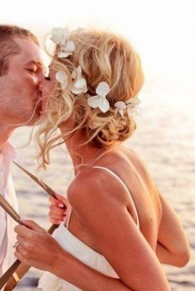 Beach Wedding. Bride hair with curly up do and flower accessories done by Les. Ciseaux St. Armands