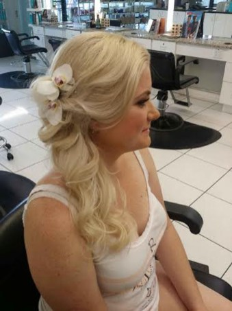 Wedding hair with flower accessory side half updo by Les Ciseaux St. Armands