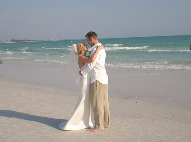 Bride and Groom beach wedding. Wedding hair and make up by Les Ciseaux