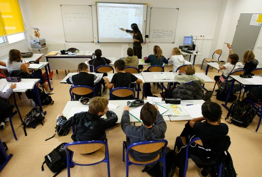 French junior high students follow a geography lesson taught with a digital touch blackboard at the Rene Cassin school in Tourette Levens, near Nice