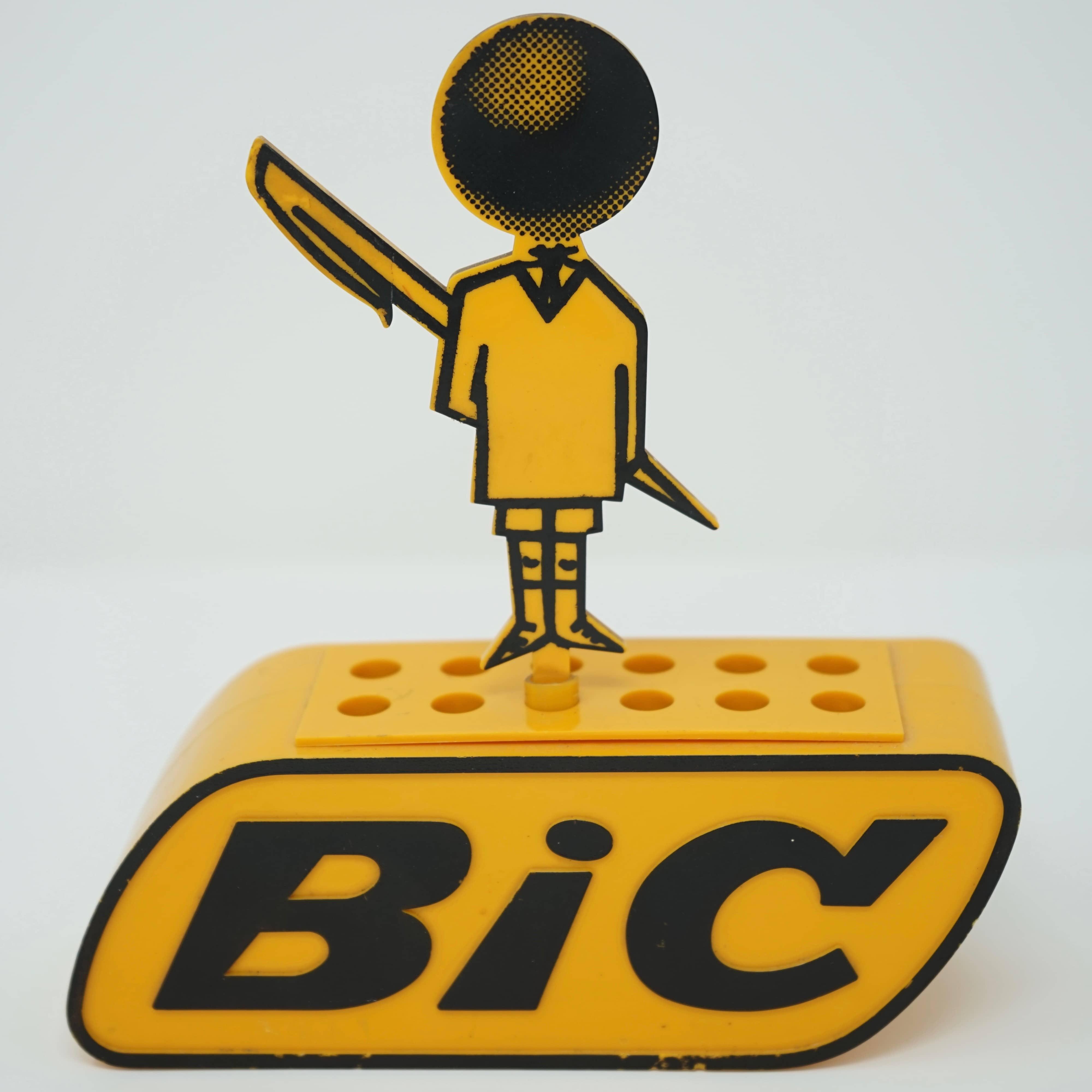 Présentoir à stylos BIC publicitaire des années 60 aux couleurs de la marque (orange et noir)