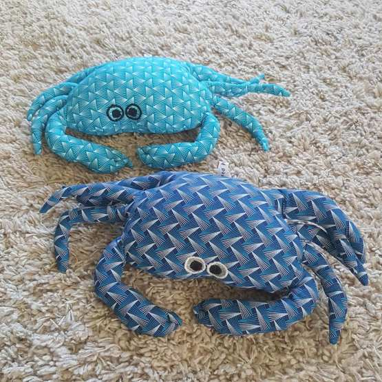 Petits coussins crabes repose-tête bleus