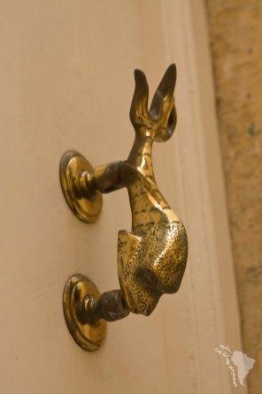 Poignée de porte dauphin