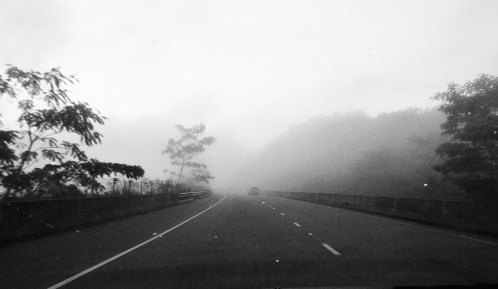 Disappearing into the unknown . . . Early morning fog on the highway.