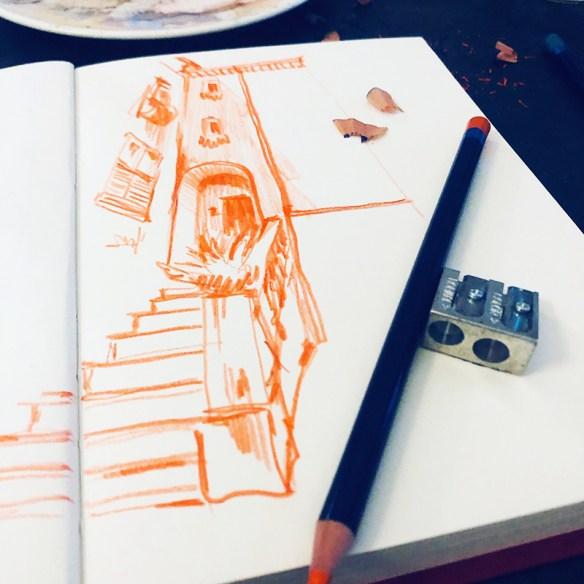 dessin avec un crayon de couleur orange
