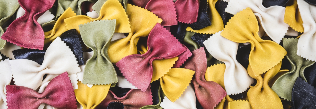 Colorful uncooked gourmet bowtie pasta