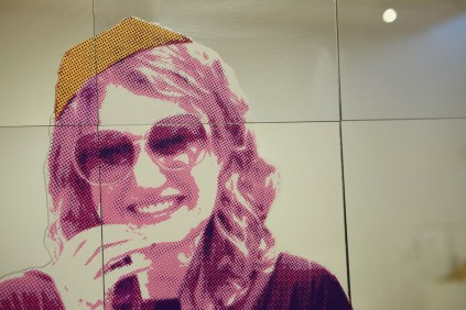 "Yarmulke Girl (detail), 8' x 20' x 2"", mixed media: screenprints on mirror, foam, and wood, 2011."